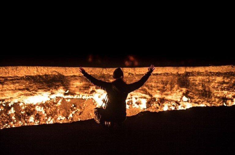 Turkmenistan, Door to Hell, Gates of Hell, Darvaza, Darvaza Crater, Darvaza Gas Crater, Darvaza Turkmenistan, Turkmenistan Gas Crater, Turkmenistan Crater, Gas Crater, Central Asia, Derweze, Derweze Turkmenistan, Derweze Crater, Derweze Gas Crater, Ahal, Ahal Province, Woman Door to hell, Woman gas crater, woman Darvaza gas crater